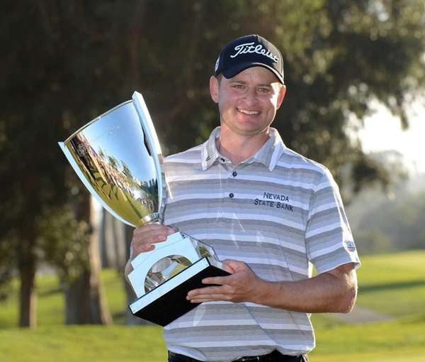 John Merrick poses with the trophy after his