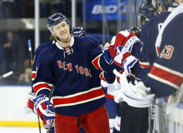Derek Stepan celebrates his third period goal against