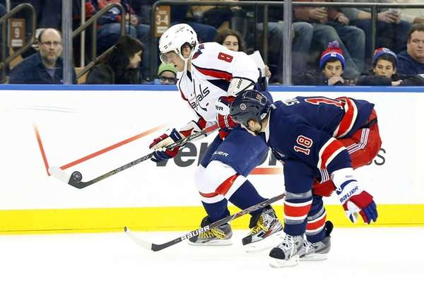 Alex Ovechkin #8 of the Washington Capitals tries