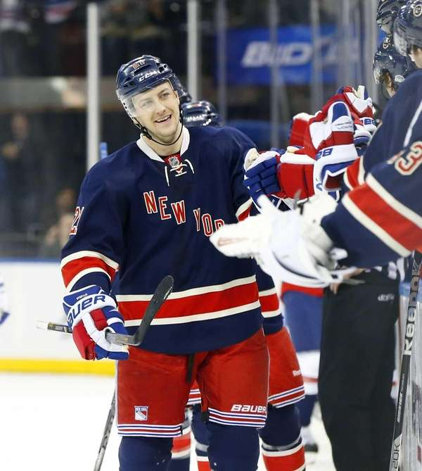 Derek Stepan celebrates his third-period goal during a