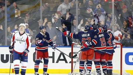 The Rangers celebrate a third-period goal scored by