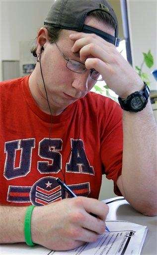 Student Keith Holmes works in a GED preparation
