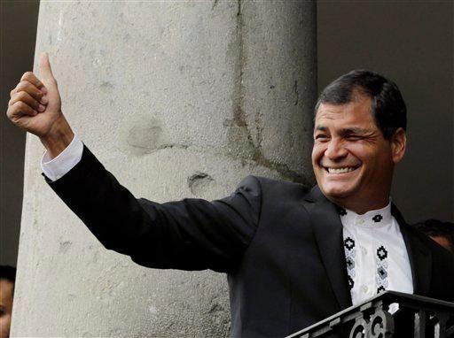 Ecuador's President Rafael Correa gives a thumbs up