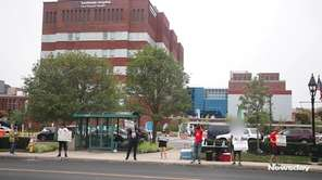 Protesters gathered outside Southside Hospital in Bay Shore on