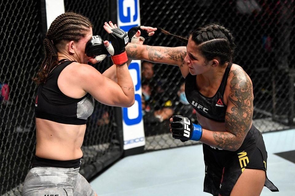 Vanessa Melo of Brazil punches Karol Rosa of