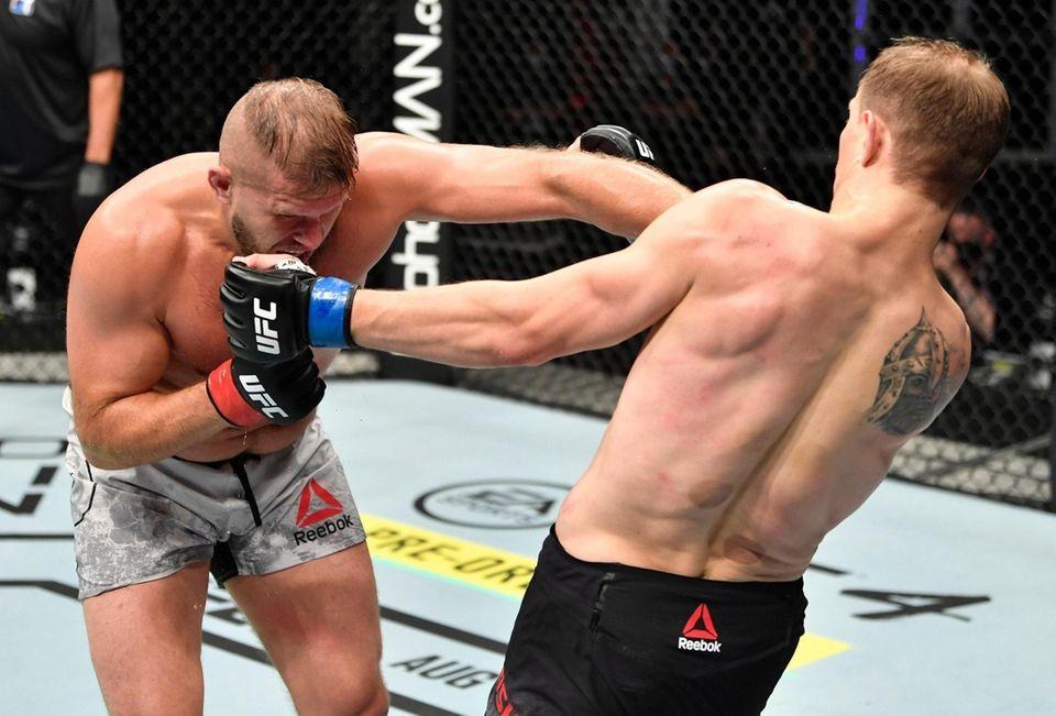 Marcin Tybura of Poland punches Maxim Grishin of