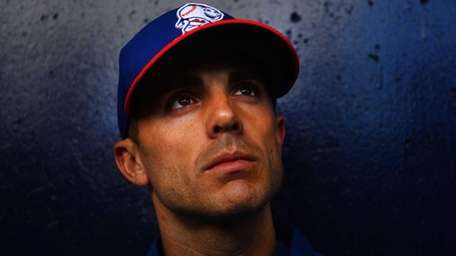 David Wright talks to the media after a