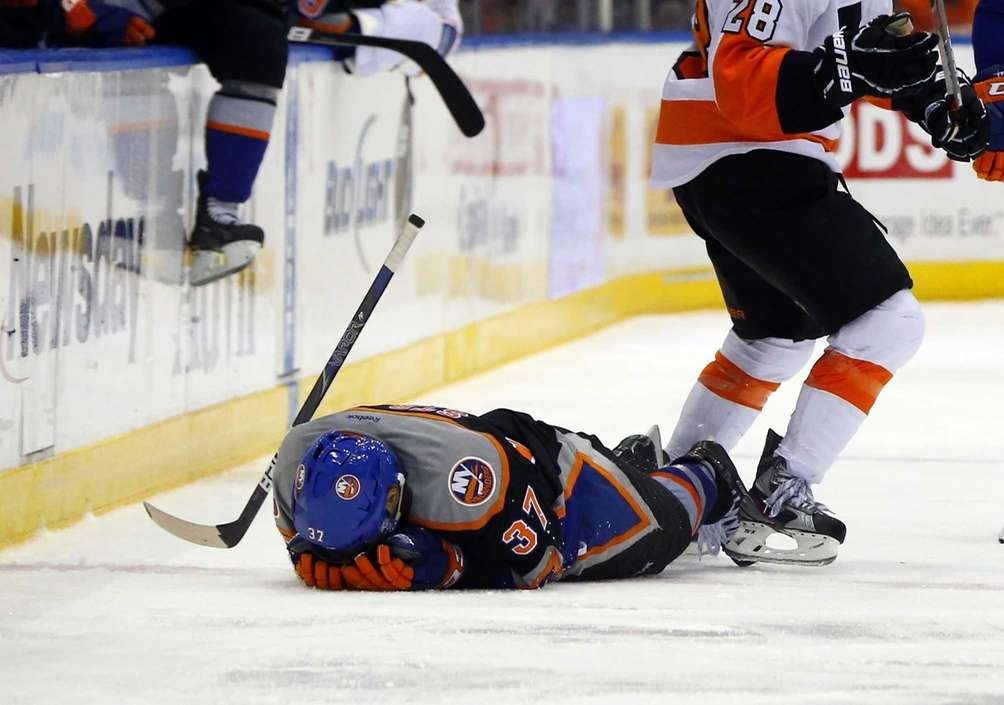 Brian Strait lays on the ice after falling