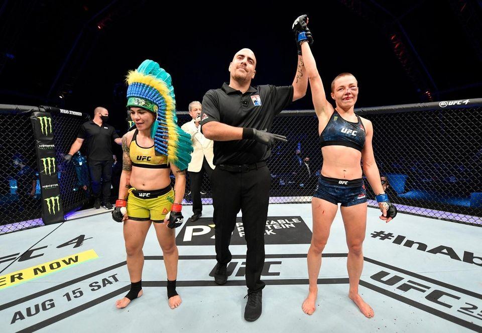 Rose Namajunas celebrates after her split-decision victory over