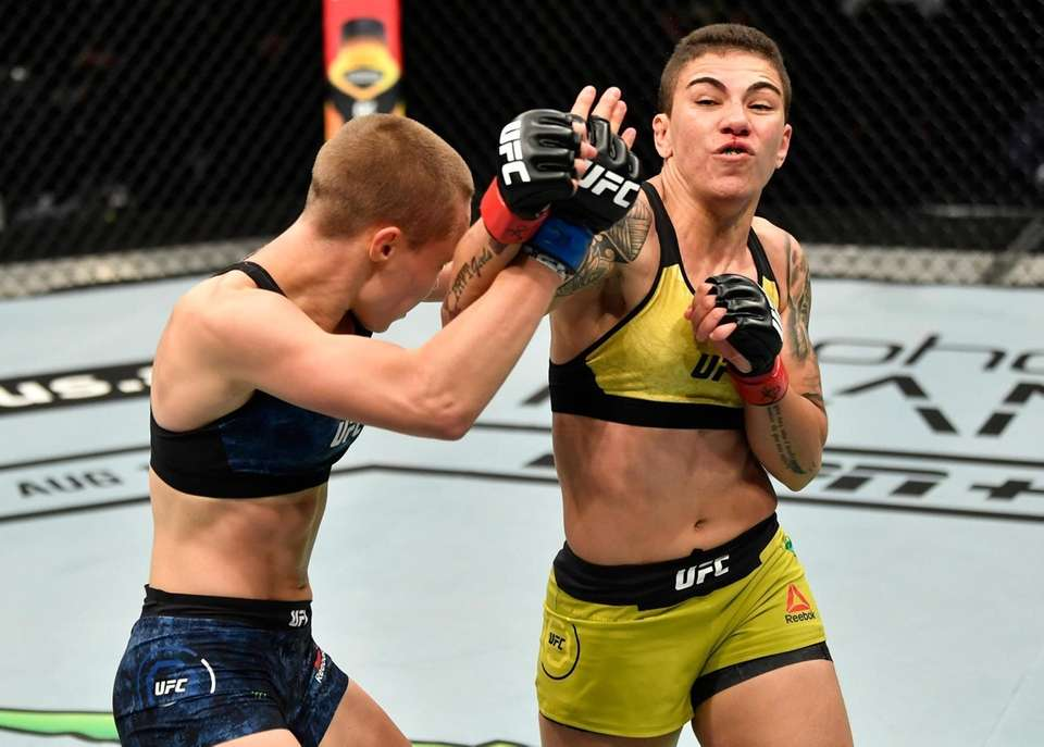 Jessica Andrade of Brazil punches Rose Namajunas in