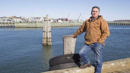 Commerical fisherman Sidney Smith, from Greenport, stands on