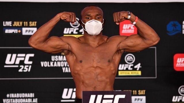 Kamaru Usman of Nigeria poses on the scale