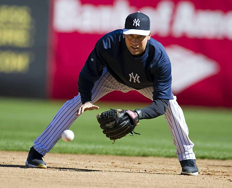 Derek Jeter fields ground balls during spring training