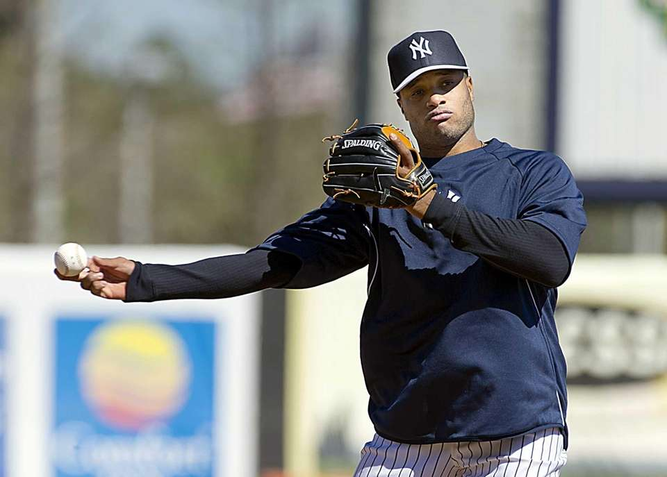 Robinson Cano throws the ball during fielding practice