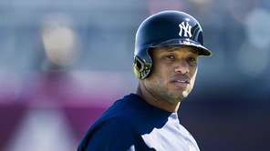Robinson Cano leaves the field after taking batting