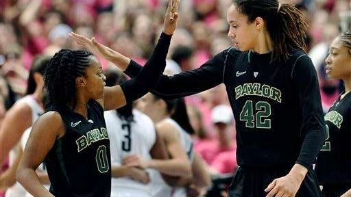 Baylor's Odyssey Sims, left, and Brittney Griner react