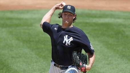 Yankees starting pitcher Gerrit Cole delivers during an