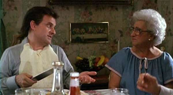 Joe Pesci as Tommy DeVito and Catherine Scorsese