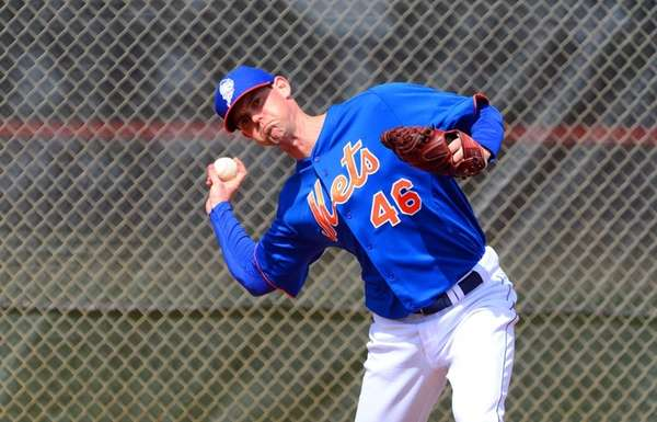 Mets pitcher Greg Burke throws a bullpen session