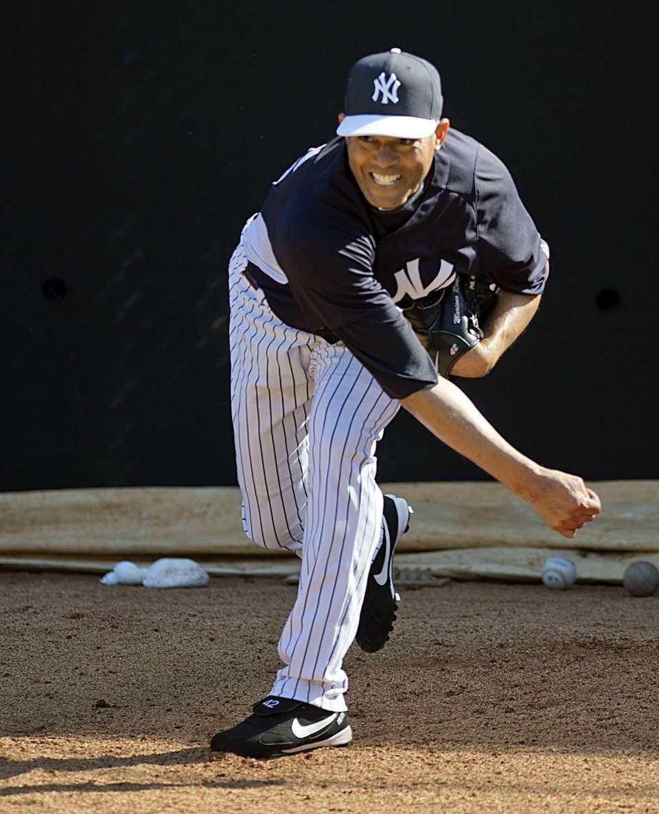 Mariano Rivera delivers a pitch in the bullpen