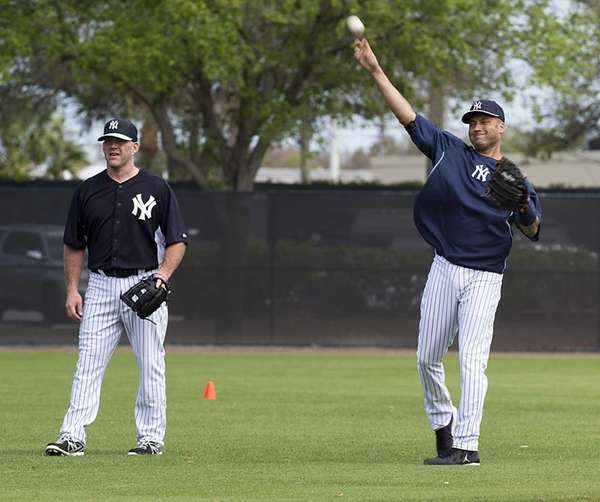 Yankees' Kevin Youkilis and Derek Jeter warm up