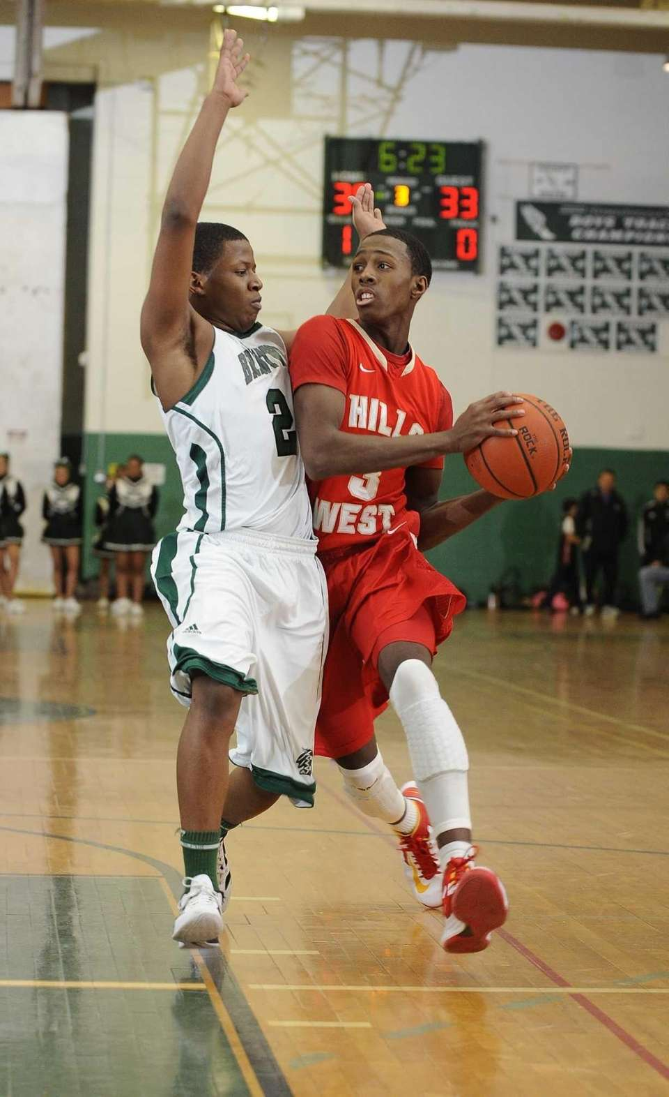 Brentwood's Vernon Hart defends against Half Hollow Hills