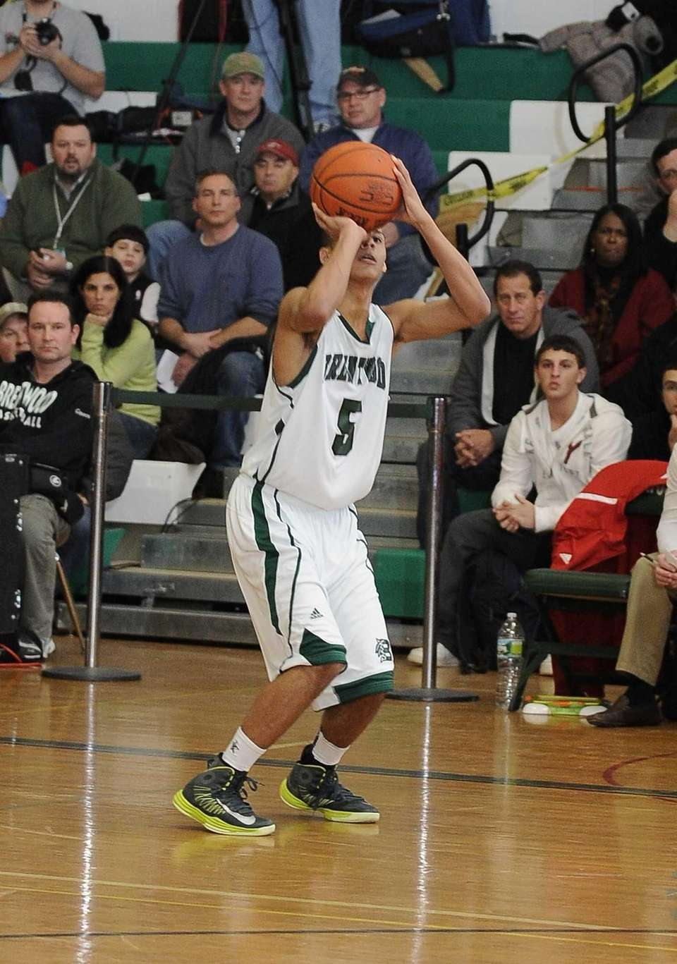 Brentwood's Michael Almonacy takes a three-point shot against