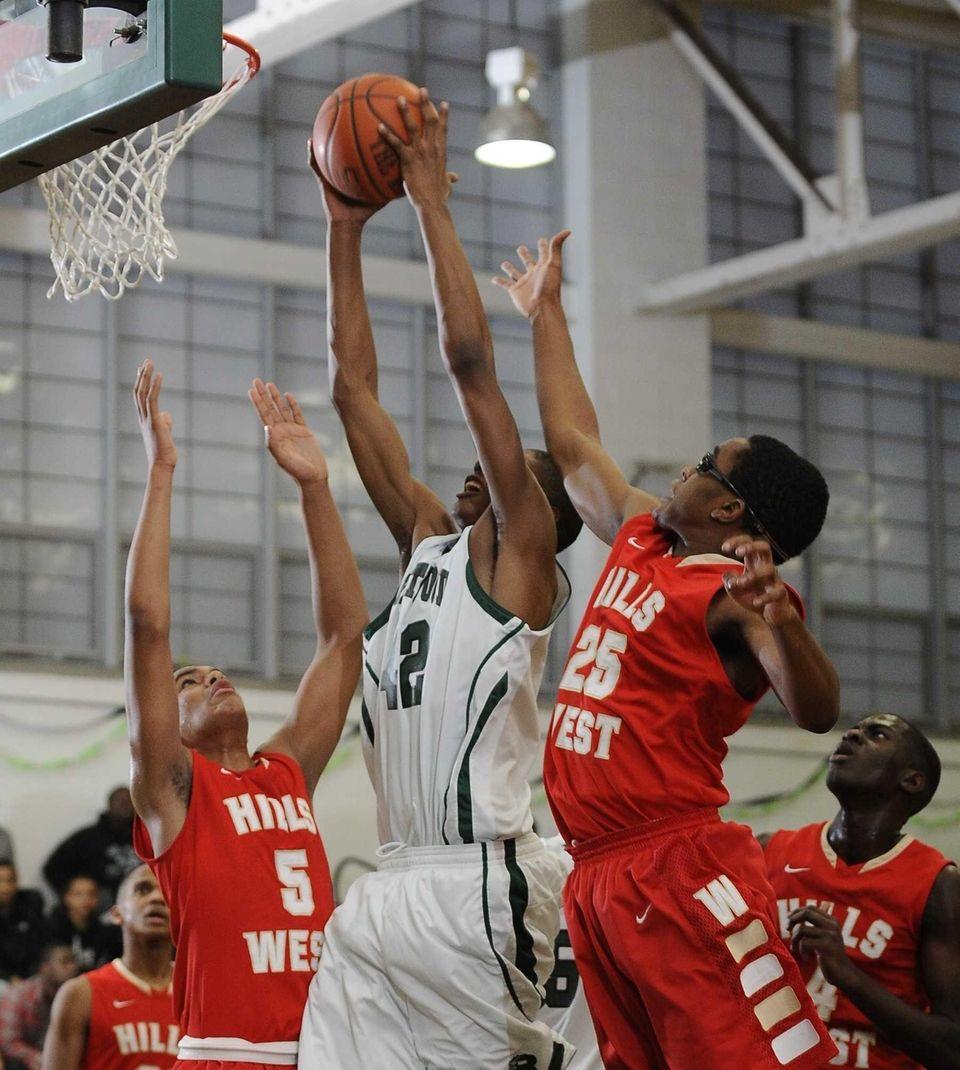 Brentwood's Jamel Allen grabs a rebound between Half
