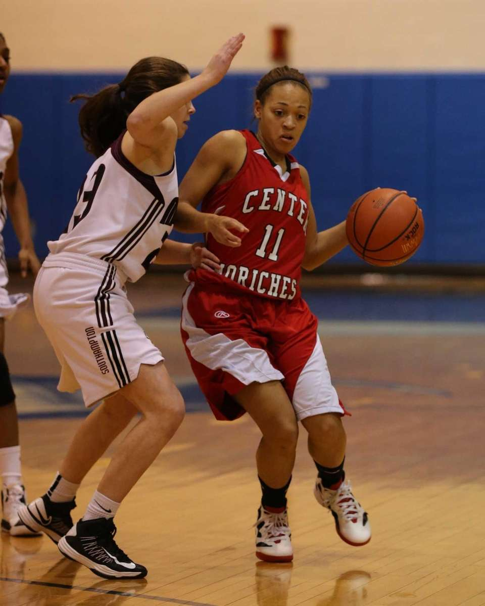 Center Moriches senior Takia Plummer moves the ball