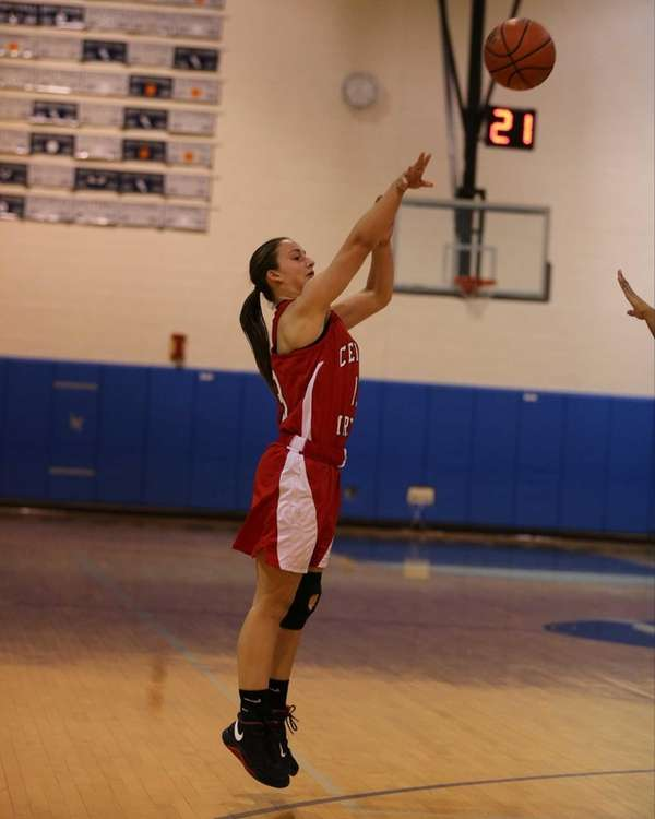 Center Moriches junior Pamela Schenck sinks a jump