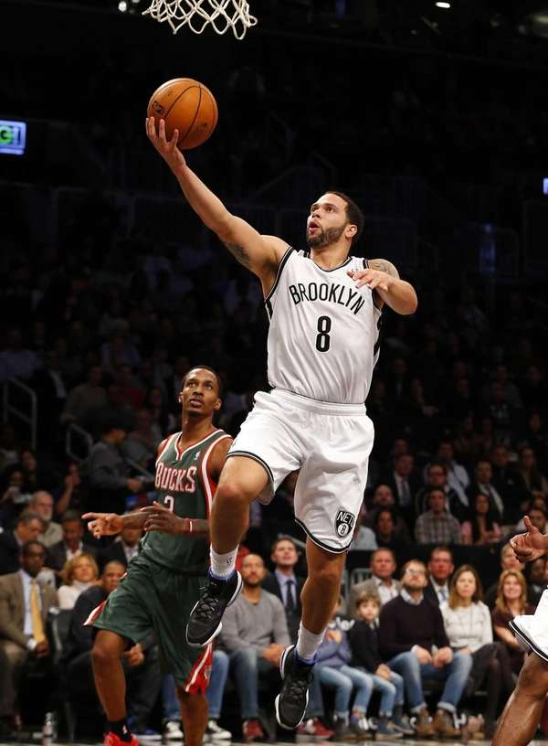 Deron Williams of the Brooklyn Nets goes to