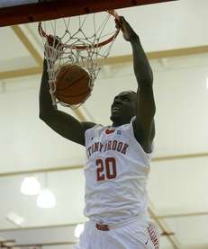 Stony Brook's Jameel Warney dunks off a pass