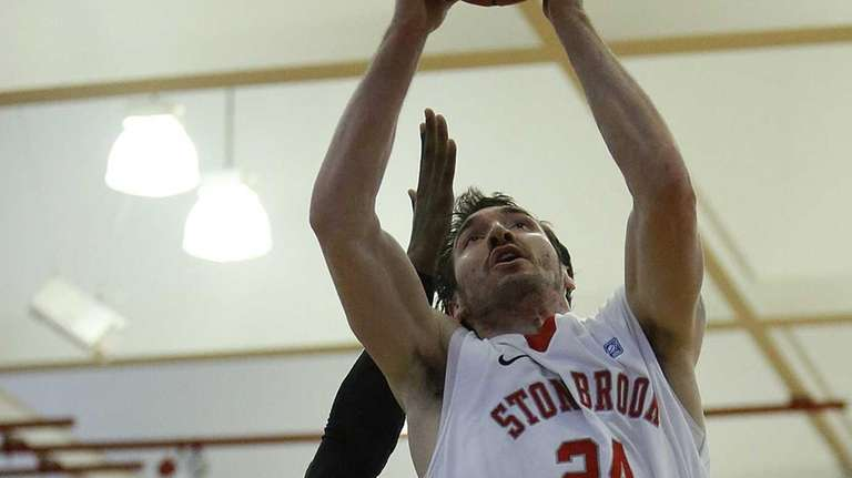 Stony Brook's Tommy Brenton is fouled by UMBC's
