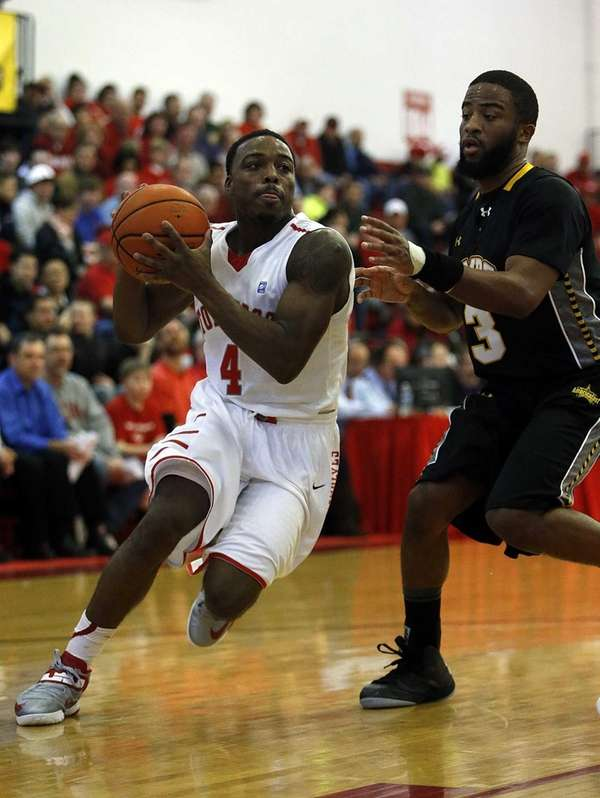 Stony Brook's Anthony Jackson drives around UMBC's Quentin