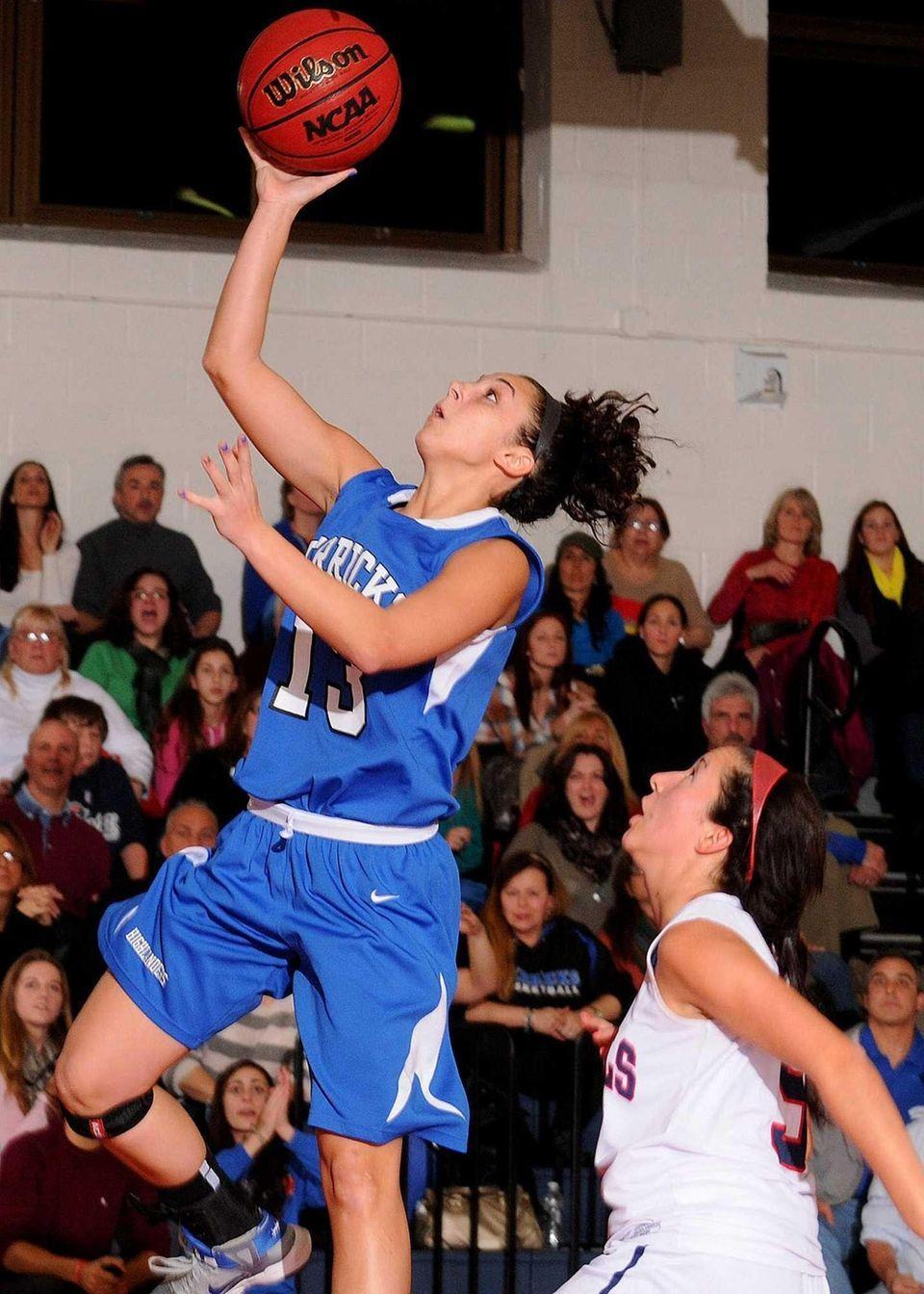 Herricks' Erin Rivera drives to the basket for