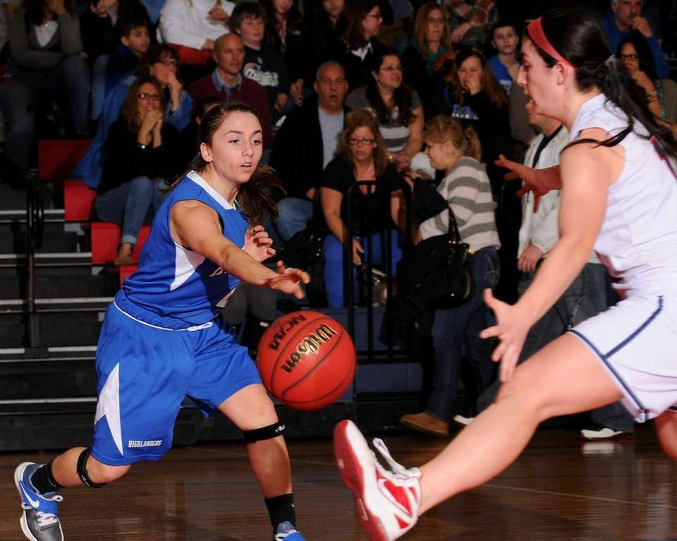 A pass by Herricks' Victoria Marano, left, gets