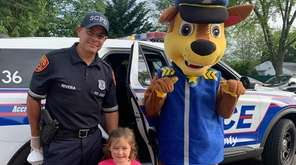 Suffolk County police officer Peter Rivera helps celebrate