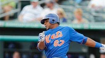 Mets' Cesar Puello bats during a spring training