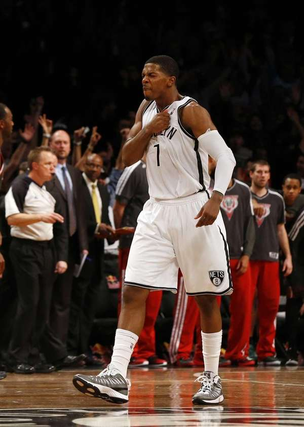 Joe Johnson of the Brooklyn Nets celebrates his