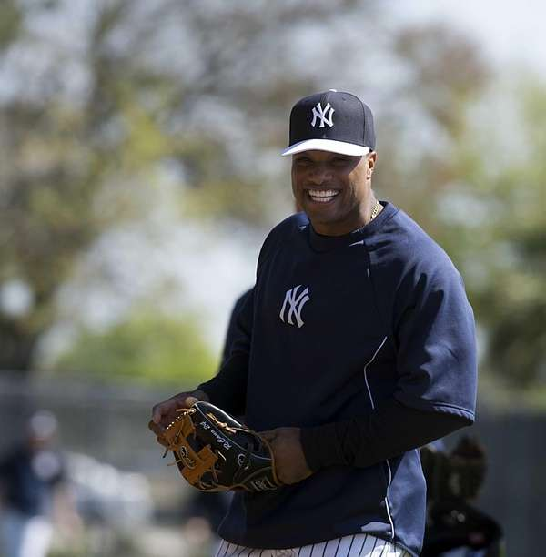 Yankees' Robinson Cano enjoys himself at practice during