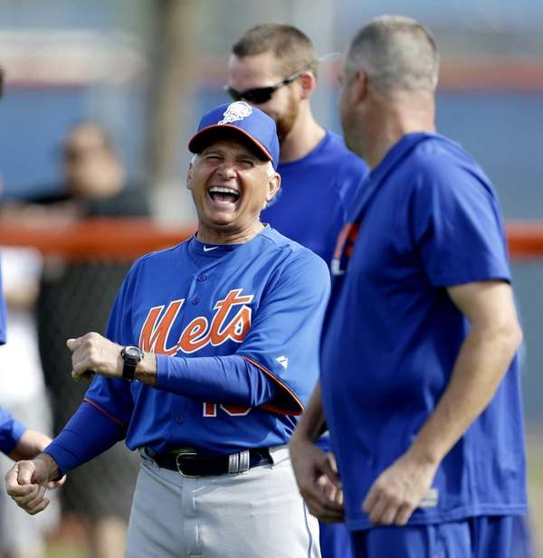Mets manager Terry Collins, left, laughs while talking