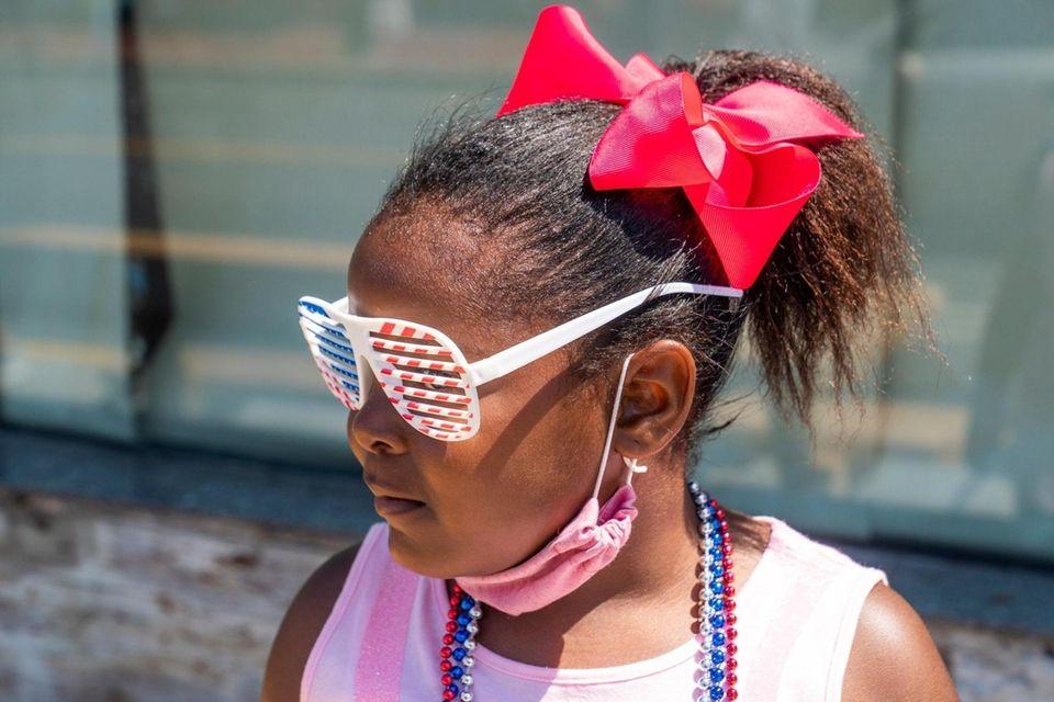 Rmonie Davis, 5, from Bellport watches the Patriot