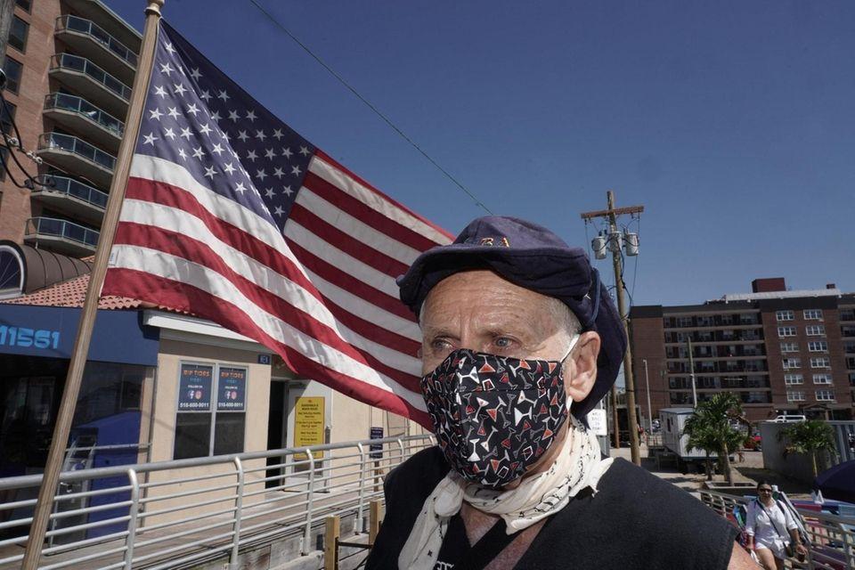 Fred Shwom, 74, of Lynnbrook, wears a mask