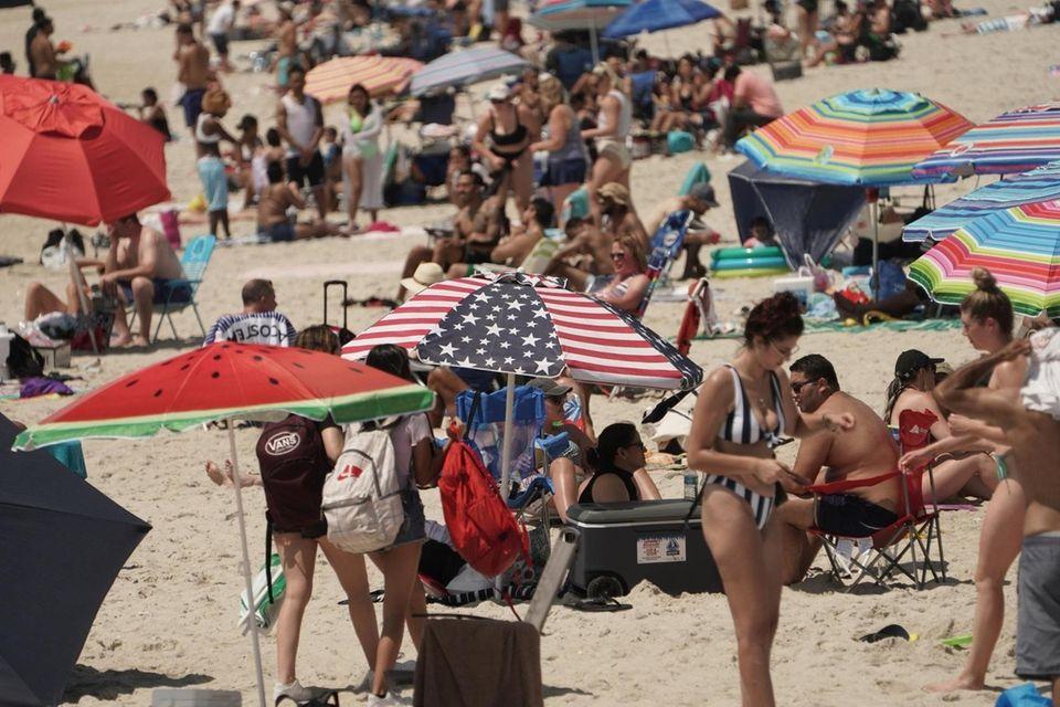 People enjoying the holiday at Jones Beach on