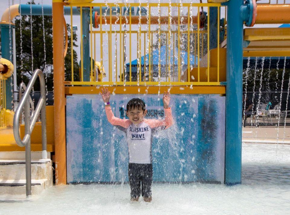 Nathan Ban, 5, Old Westbury enjoy the splash