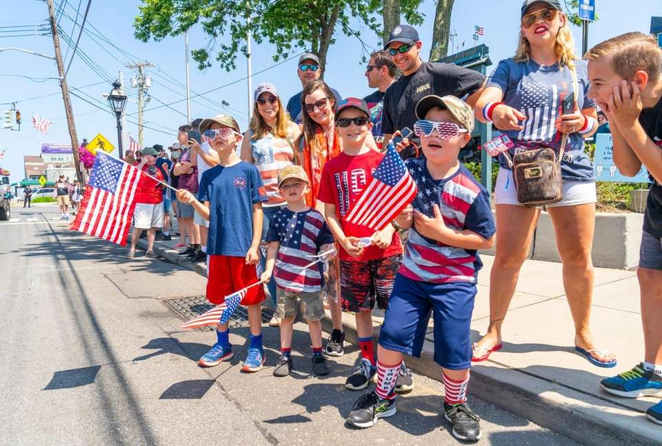 People watch the Patriot Independence Day parade in