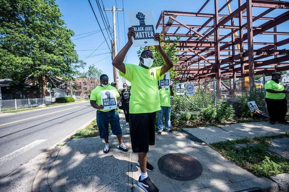 Protesters gathered at Rhodes School Construction Site in