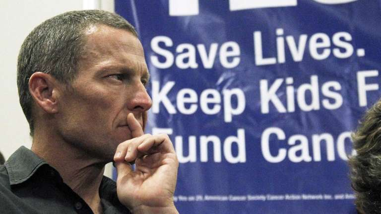 Lance Armstrong attends a rally at a news