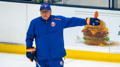 Islanders coach Barry Trotz calls a drill during