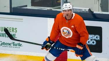 Islanders defenseman Johnny Boychuk (55) looks on during